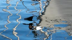 Boat reflecting on the sea Stock Footage