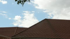 Pan terra cotta roof of building blue sky 4973 Stock Footage