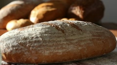 Baker put bread on table, close up HD - stock footage