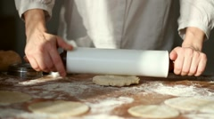 Baker kneading dough with rolling pin table HD - stock footage