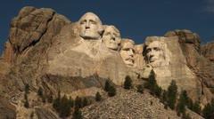 Mount Rushmore sun on faces deep blue sky.mp4 Stock Footage
