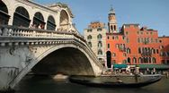 Time Lapse of Rialto Bridge in Venice, Italy, people boats and gondolas trip Stock Footage