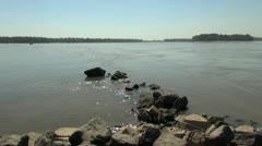 Stock Video Footage of Missouri and Mississippi confluence with rocks