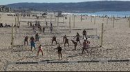 Stock Video Footage of Several groups of people playing volleyball game on the beach