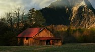 Cabin in Mountain Meadow Stock Footage