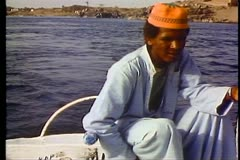 Young Nubian boy guides a felluca sailboat down the Nile 108013 Stock Footage