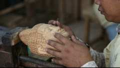Carving out a Buddha head statue Stock Footage