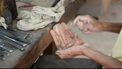 Sanding a wooden Ganesha statue Stock Footage