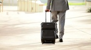 Stock Video Footage of Businessman with Smart Phone and Travel Luggage