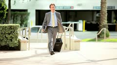 Successful Businessman Returning from Travel Stock Footage