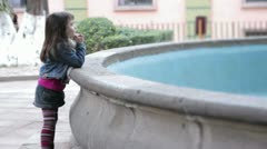 Little girl by Fountain Stock Footage