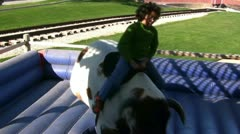 Kid Riding Mechanical Bull In Texas Stock Footage