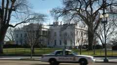 The White House with Police car drive by, winter, zoom out Stock Footage