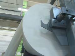 Paper wrapped out from huge roll by printing house equipment. - stock footage