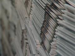 Huge piles of printed newspapers printing shop. Stock Footage