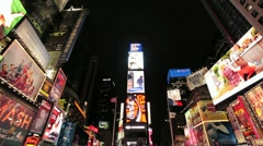 Times Square New York City at night wide tilt down Stock Footage