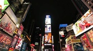 Stock Video Footage of Times Square New York City at night wide tilt down