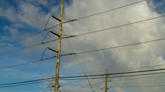 Electric power cables with rainbow background. Stock Footage