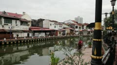 Buildings along Melaka River in Malacca Malaysia 1080p Panning Stock Footage