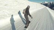 Snowboarder from behind in Austria Stock Footage