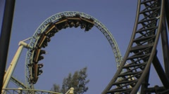 2 Looping Roller Coasters - Theme Park Amusements Ride HD Stock Footage