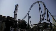 Stock Video Footage of Theme Park Amusement - Saw Themed Roller Coaster Ride HD