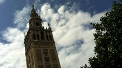 Seville Cathedral Tower Against Blue Sky with Clouds Stock Footage