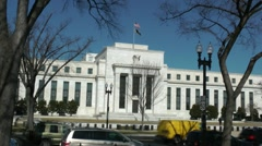 U.S. Federal Reserve Building with traffic in Washington, DC Stock Footage