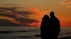 Mature Couple Watching Sunset Stock Footage