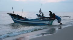 Fishing boats launching into the ocean - stock footage
