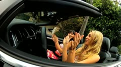 California Girls in Luxury Convertible Stock Footage