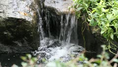 Artificial waterfall  in garden Stock Footage