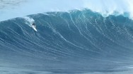 Stock Video Footage of maui, hi - march 13: professional surfer rides a giant wave at the legendary