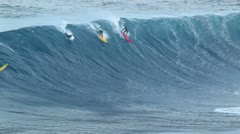 maui, hi - march 13: professional surfers ride a giant wave at the legendary - stock footage