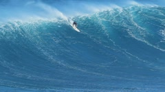 Maui, hi - march 13: professional surfer rides a giant wave at the legendary Stock Footage