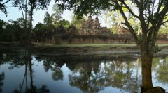 Banteay Srei temple with moat in jungle, Cambodia, Asia Stock Footage