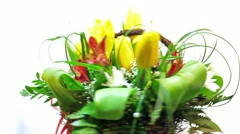 Rotating bouquet of spring tulips flowers with green leaves Stock Footage