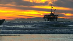 Surfer Walking Beach Oil Rig Stock Footage