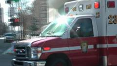 DC EMS ambulance maneuvers through city downtown. Stock Footage