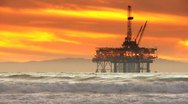 Stock Video Footage of Coastal Oil Rig Sunset