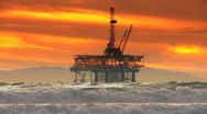 Stock Video Footage of Oil Platform Offshore Sunset