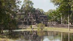 Baphuon temple in the jungle, Cambodia, Asia Stock Footage