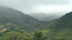 Panama, cloud shrouded valley, hilly agricultural plots, medium shot - stock footage