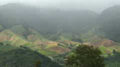 Panama, cloud shrouded valley, hilly agricultural plots, wide shot - stock footage