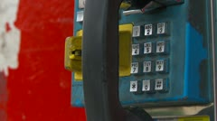 Rural third world payphone, zoom back Stock Footage