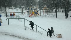 Winter Park, children sledding in the snow from the mountain Stock Footage