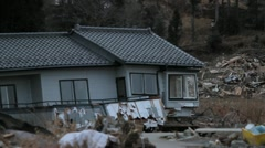 Japan Tsunami Aftermath- Rack Focus to Destoyed House Stock Footage