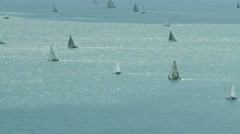 Fleet of yachts seen from cliffs Stock Footage
