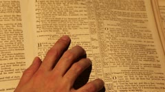 Hand assisting the person to read Psalm 4:8 Stock Footage