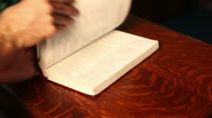 Opening bible on pulpit - stock footage
